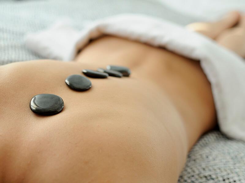 Manualna terapija in masaže Bruno Modno frizerstvo Frizerski salon Yvonne Hot stone - masaža z vročimi kamni 2